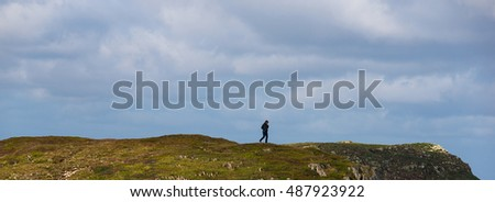 Female hiker on a coastal trail