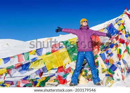 Female hiker standing on the Himalaya pass with clear sky background  - stock photo