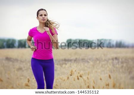 Female Hispanic Runner Outdoors - stock photo