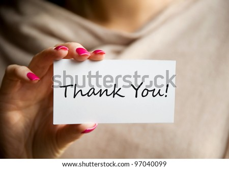 Female holding a white Thank You card - stock photo