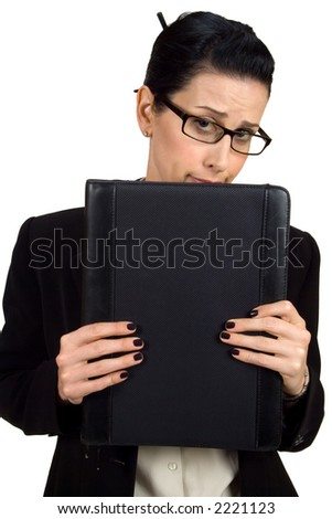 Female holding briefcase looking shy - stock photo