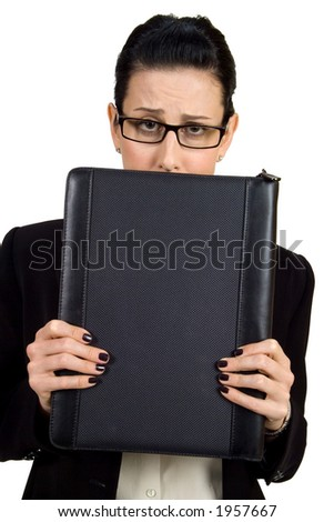 Female holding briefcase looking worried - stock photo