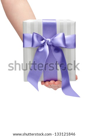 female holding gift box with a bow isolated on white background - stock photo