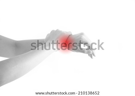 Female holding hand to spot of wrist pain with red alert accent - stock photo