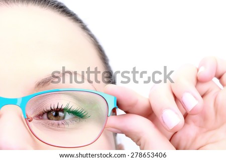 Female holding her glasses and looking straight closeup on white - stock photo
