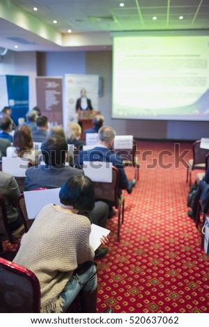 Female Host Speaker Speaking in Front of the Audience During Conference.Vertical Image Orientation