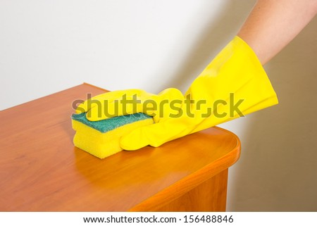 Female household, cleaning with rag and gloves.