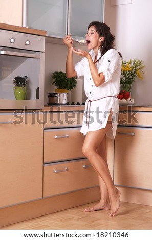 Female housewife testing her meal - stock photo