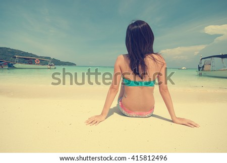female in bikini on beach vintage retro look without face