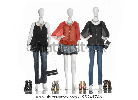 female in jeans with bag and shoe on full-length three mannequin   - stock photo
