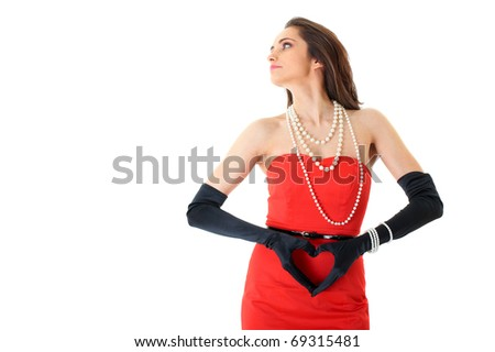 female in red dress with hands in the shape of heart, studio shoot isolated on white - stock photo