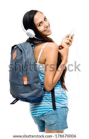Female Indian student woman listening music mobile phone - stock photo