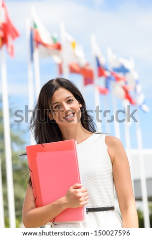 Female international student scholarship in college campus. International and languages education concept. - stock photo