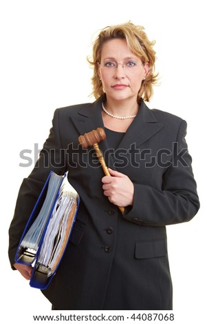 Female judge carrying files and wooden hammer - stock photo