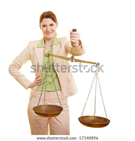 Female judge holding a beam balance in her hand - stock photo