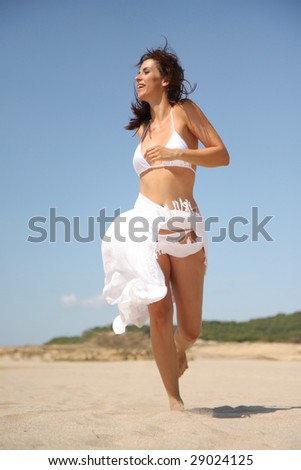 Female jumping across in holiday - stock photo