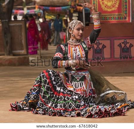 Female kalbelia dancer in traditional tribal dress performing at the annual Sarujkund Fair near Delhi, India - stock photo