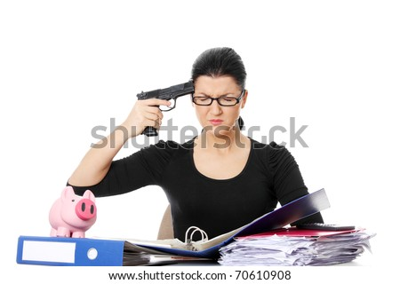 Female killing her self while filling out tax forms while sitting at her desk. Isolated - stock photo