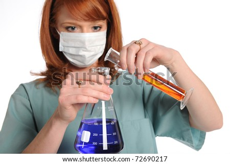 Female laboratory tech mixing chemicals isolated over white background - stock photo