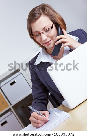 Female lawyer giving consultation by phone with laptop in the office - stock photo