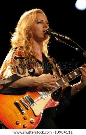 "female lead guitarist  of the group ""Amalgamation"" playing in live concert"