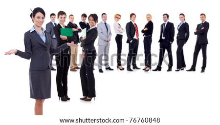 Female leader presenting her successful business team, isolated - stock photo