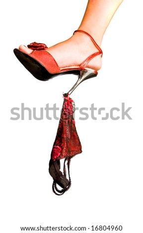 Female leg rejecting a shoe heel red shorts - stock photo