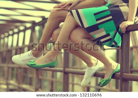 Female legs and green shoes - stock photo