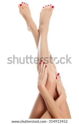Female legs and hands against a white background, isolated - stock photo