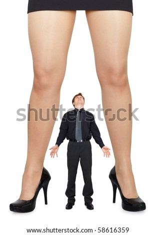 Female legs and little amazed man on white background - stock photo