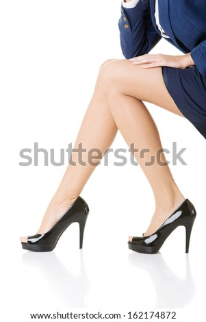 Female legs, Closeup. High heels. Isolated on white.