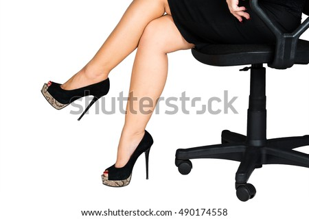 Female Legs In An Office Chair, Black Shoes, High Heel