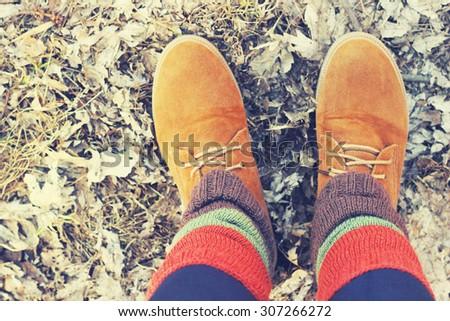 female legs in autumn orange  shoes, boots - stock photo