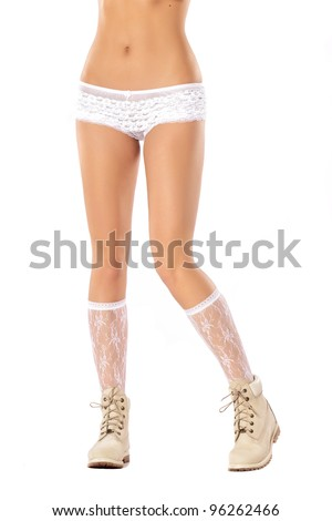 Female legs in boots - stock photo