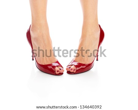 Female legs in red peep toes over isolated white background (medium format image 60 megapixels) - stock photo