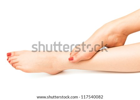 female legs in stockings on a white background - stock photo