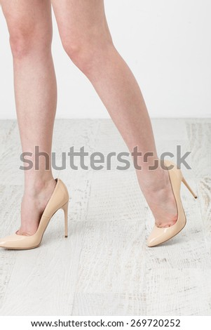Female legs in the high heel shoes