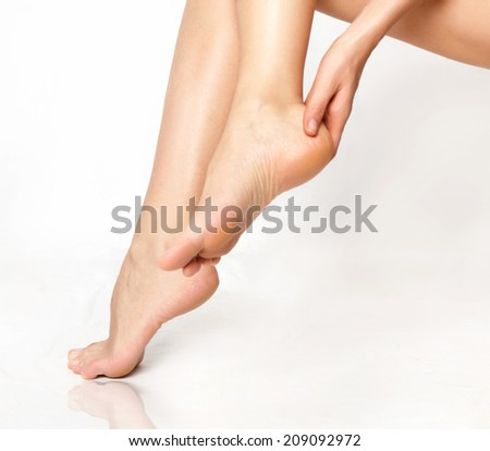 Female legs isolated on white. Depilation or another healths concept - stock photo