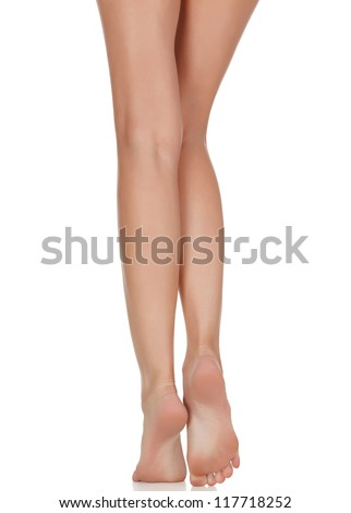 Female legs with pink heels isolated on white background - stock photo