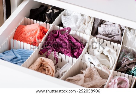 Female linen in the shelf - closeup shot - stock photo