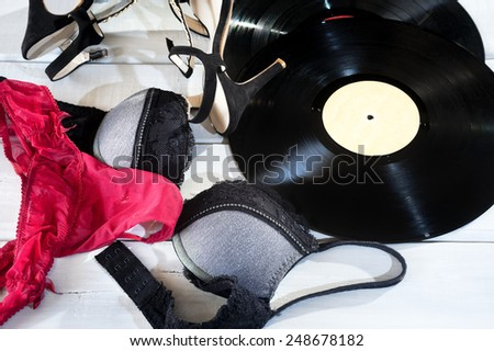 Female lingerie and accessories on floor - stock photo