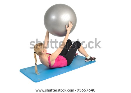Female lying abs crunching exercise with fitness ball. position 2 of 2. - stock photo