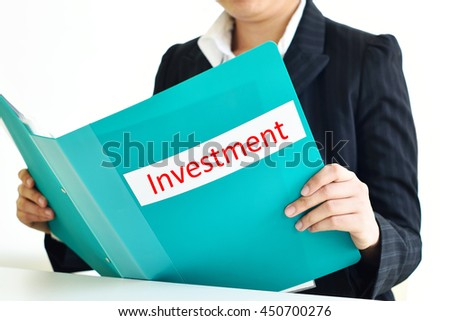 Female manager holding investments document file  - stock photo