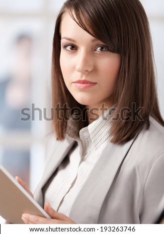 Female manager with tablet at the office, isolated on white - stock photo