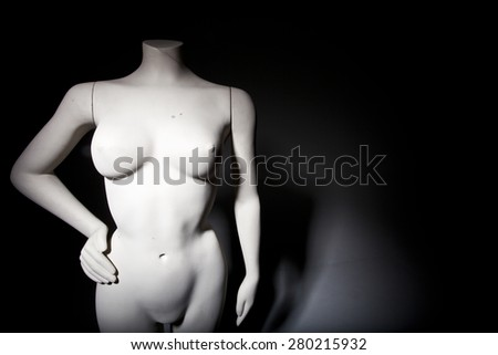 Female mannequin with moody lighting - stock photo
