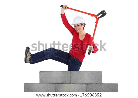 Female manual worker bolt-cutters - stock photo