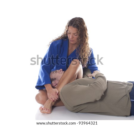 Female martial artist trapping an opponent  - stock photo
