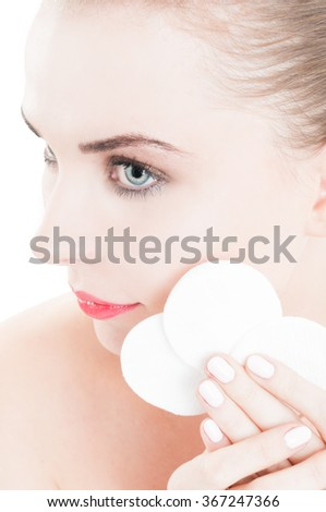 Female mdoel using cotton disc cleaner or makeup remover as skincare concept