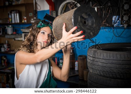 Female mechanic at work. auto service station, working girl. woman working in the garage - stock photo