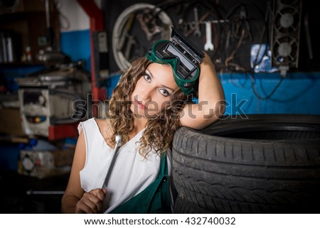 Female mechanic at work. auto service station, working girl. Young sexy woman working in the garage.